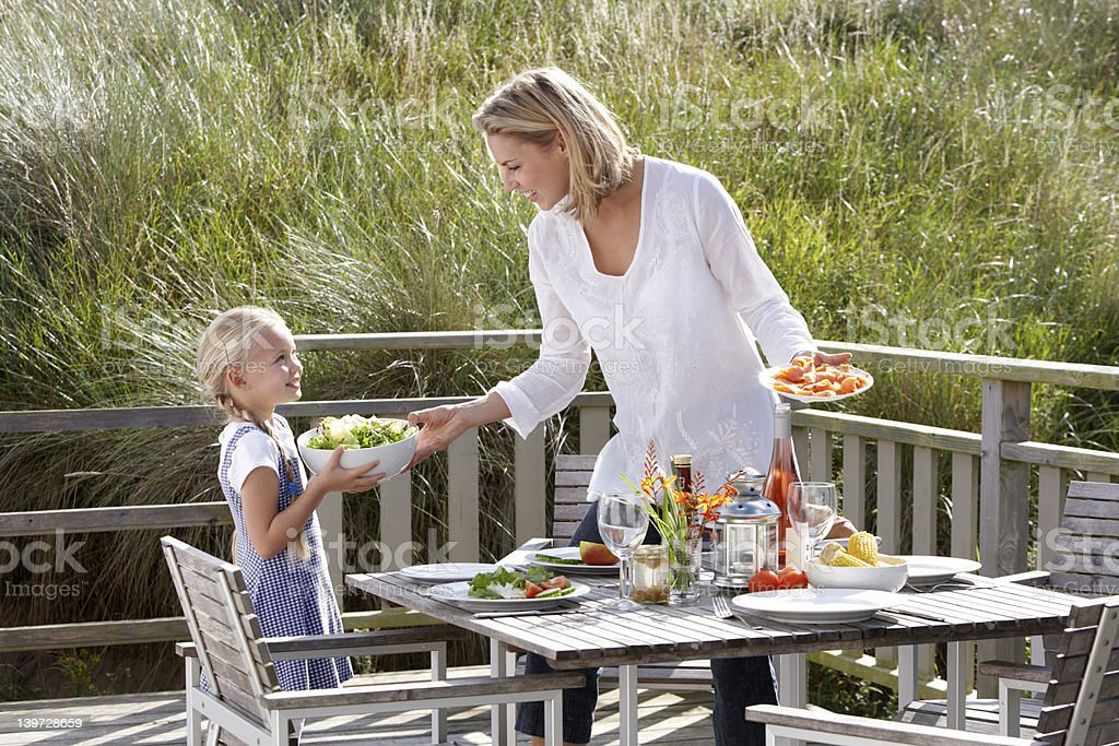 Mother and daughter eating outdoors stock photo