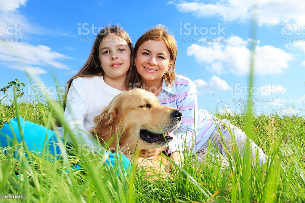 Mother and daughter enjoy nature with pet. royalty-free stock photo