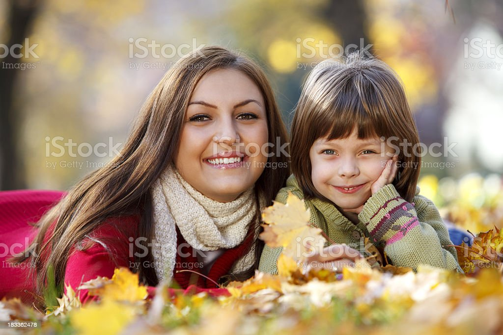 Mother and daughter enjoying autumn in park royalty-free stock photo