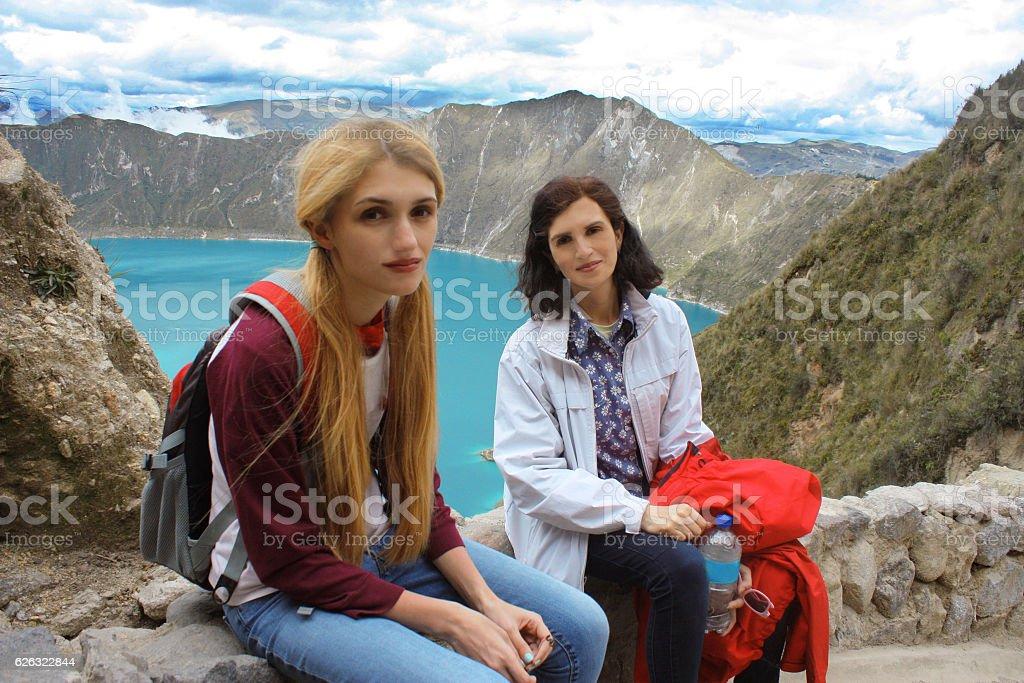 Mother and daughter enjoying nature on mountain lake Quilotoa, Ecuador stock photo