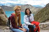 Mother and daughter enjoying nature on mountain lake Quilotoa, Ecuador
