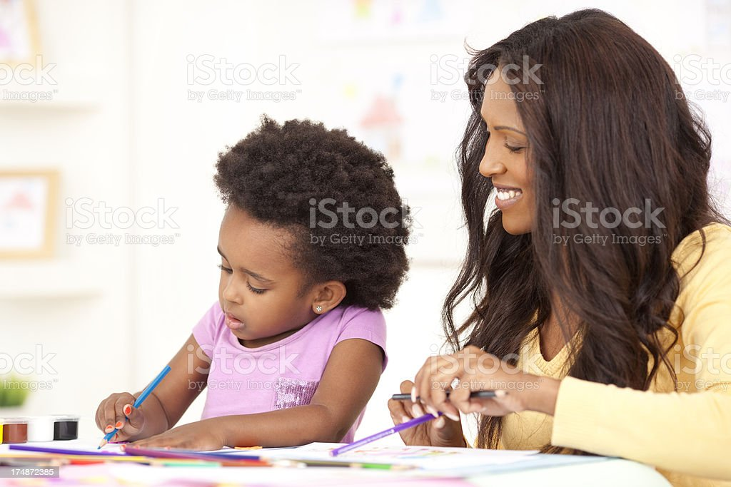 Mother and daughter enjoying painting. royalty-free stock photo