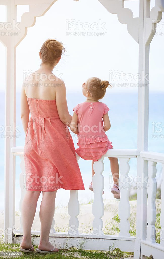 Mother and daughter enjoying sea view royalty-free stock photo