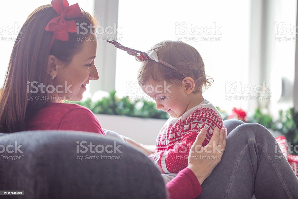 Mother and  daughter enjoying the holidays at home stock photo