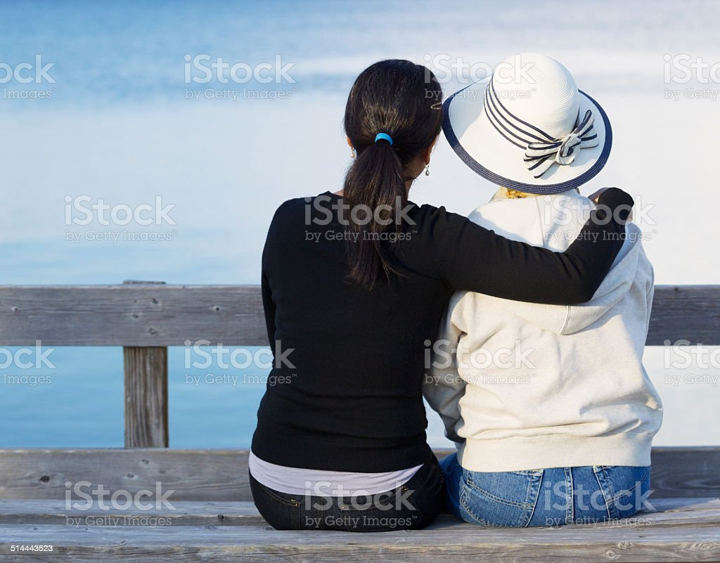 Mother and Daughter enjoying their time at the lake stock photo