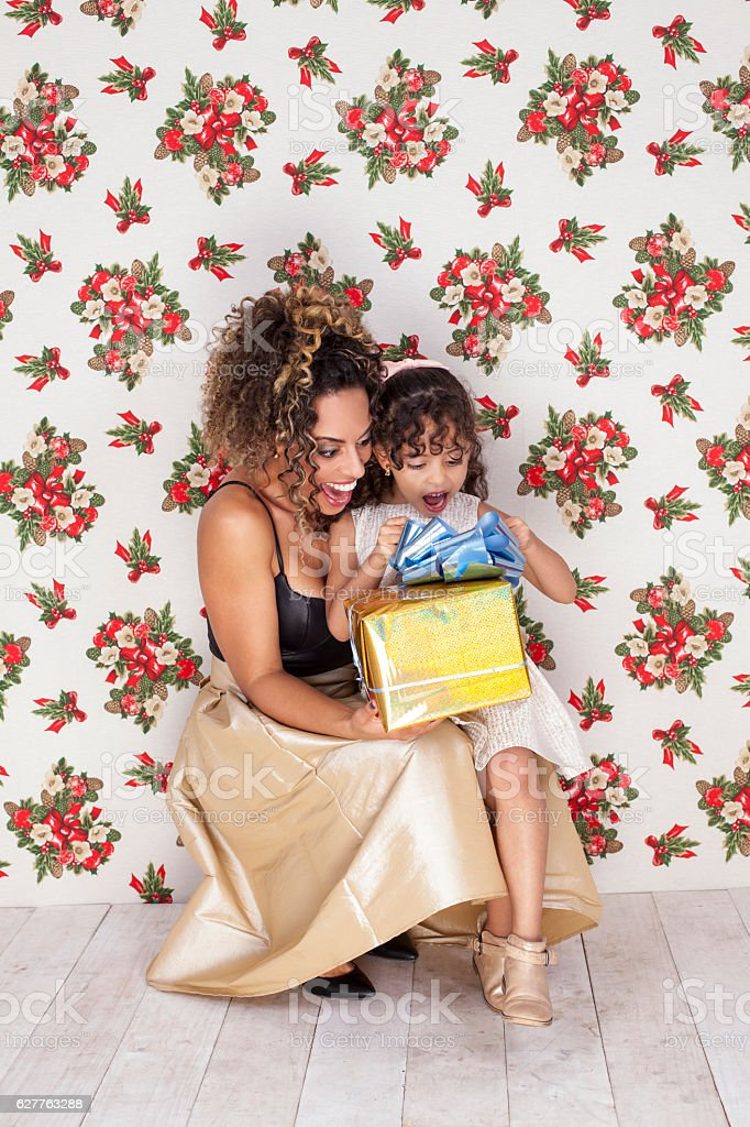 Mother and daughter Enjoying your new gift stock photo