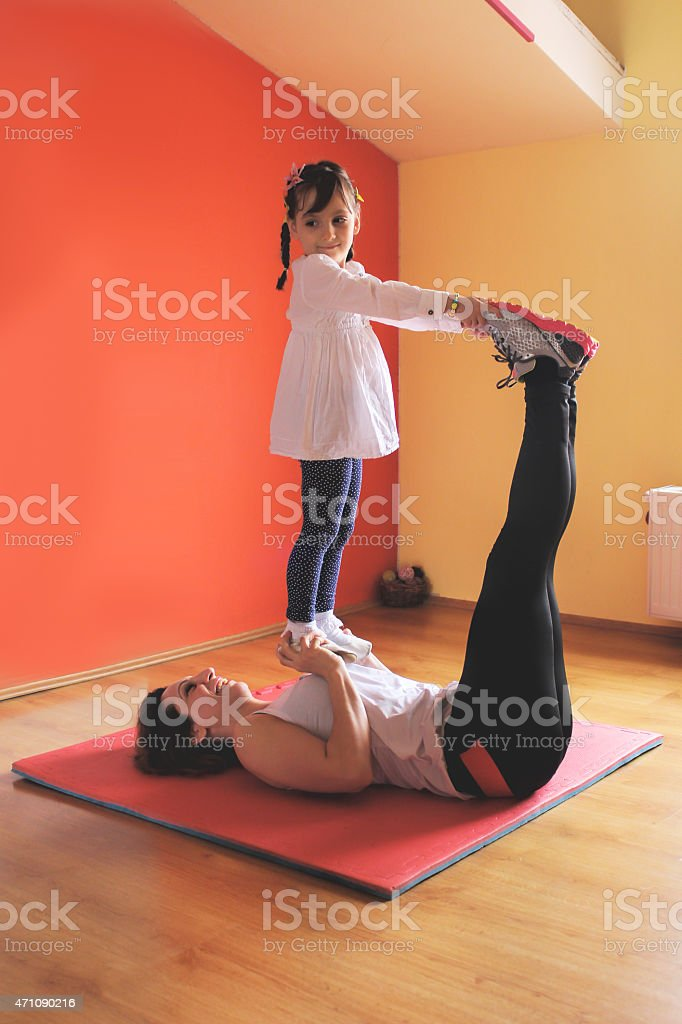 mother and daughter exercise stock photo