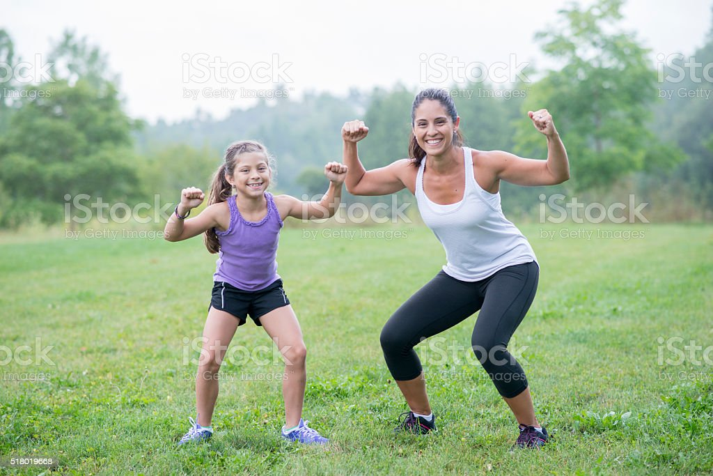 Mother and Daughter Flexing stock photo