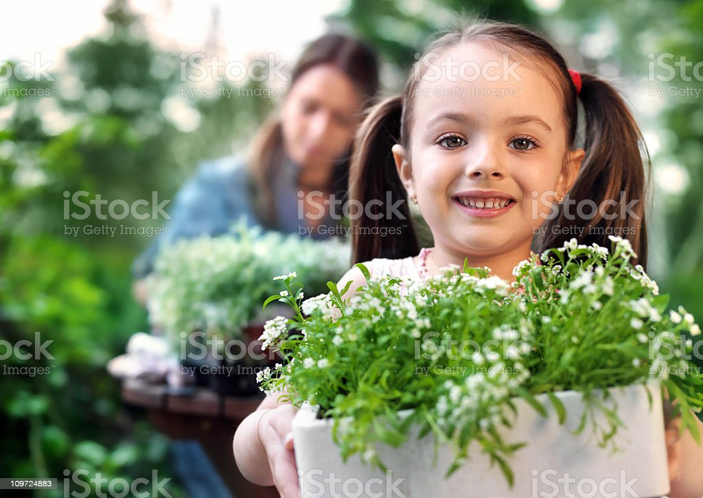 Mother and daughter gardening royalty-free stock photo