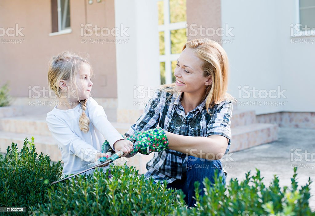 Mother and daughter gardening together royalty-free stock photo