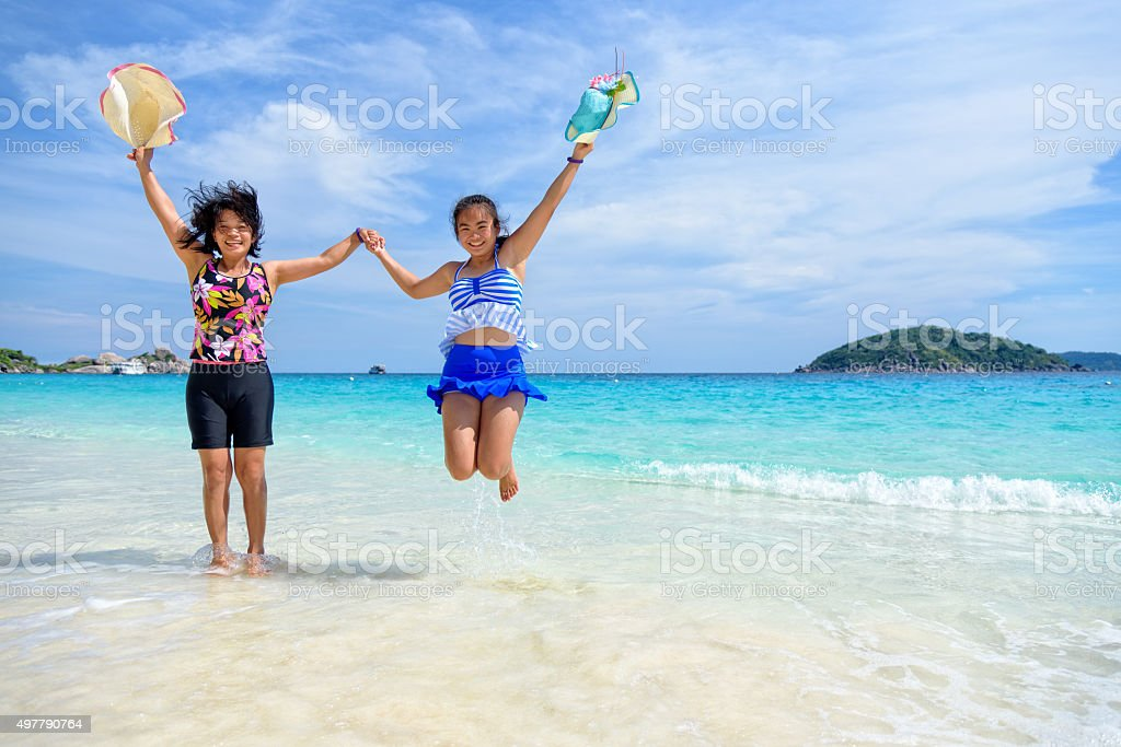 Mother and daughter happy on the beach stock photo