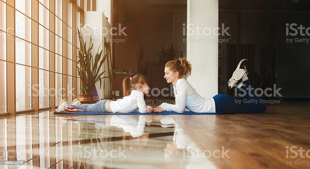 Mother and daughter have fun in the gym stock photo