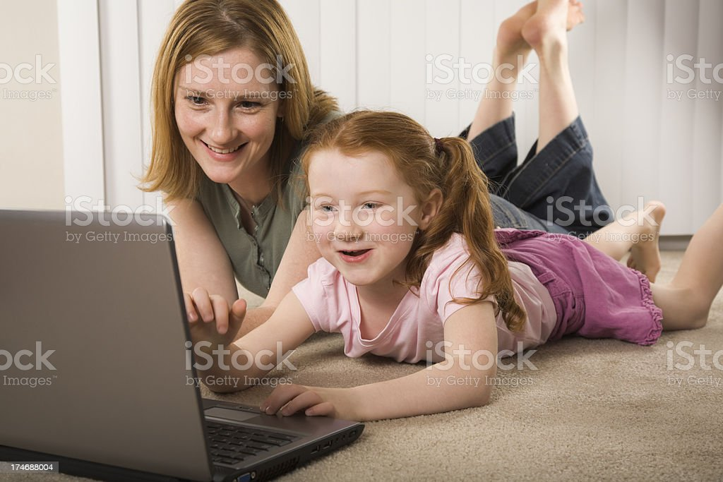 mother and daughter having computer fun royalty-free stock photo