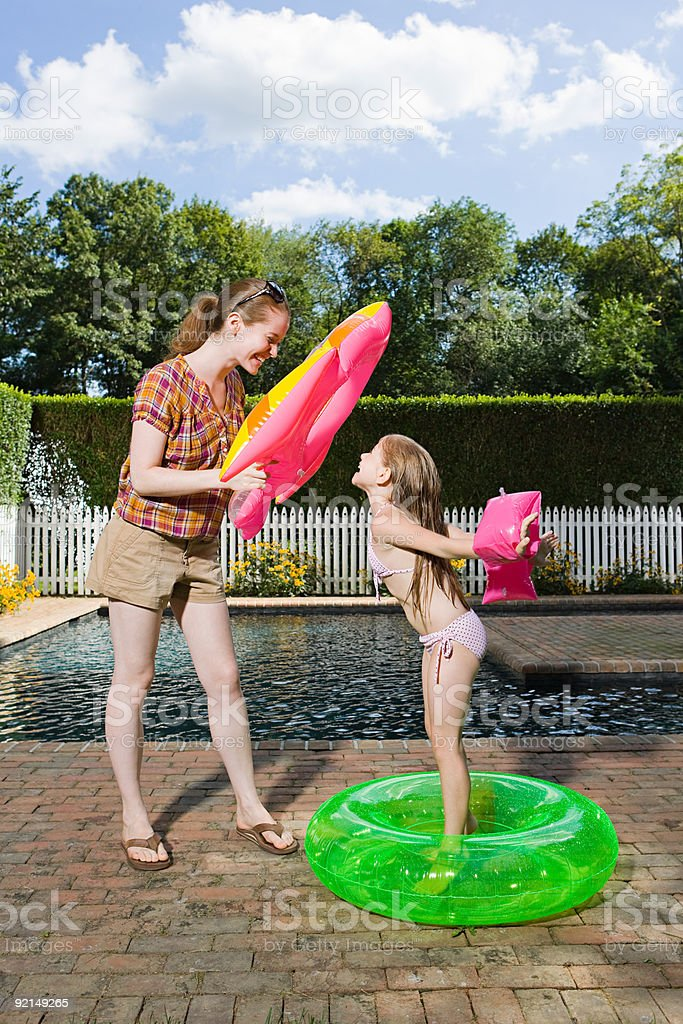 Mother and daughter having fun by the pool royalty-free stock photo