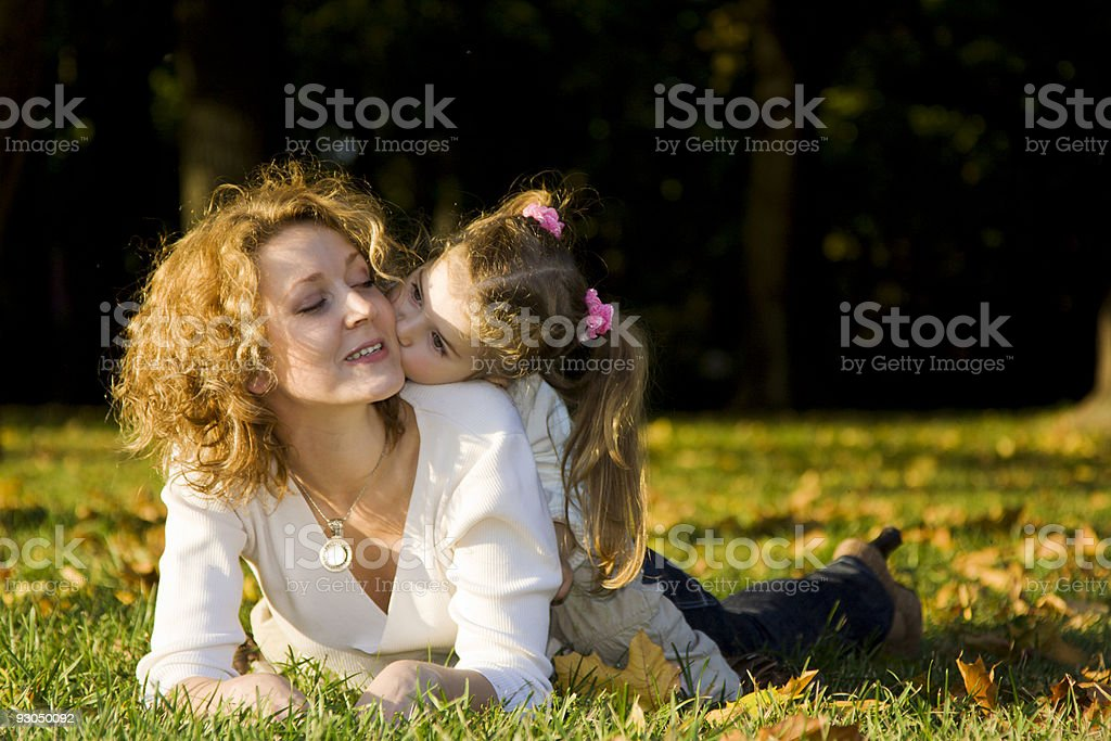 Mother and daughter having fun in autumn park royalty-free stock photo