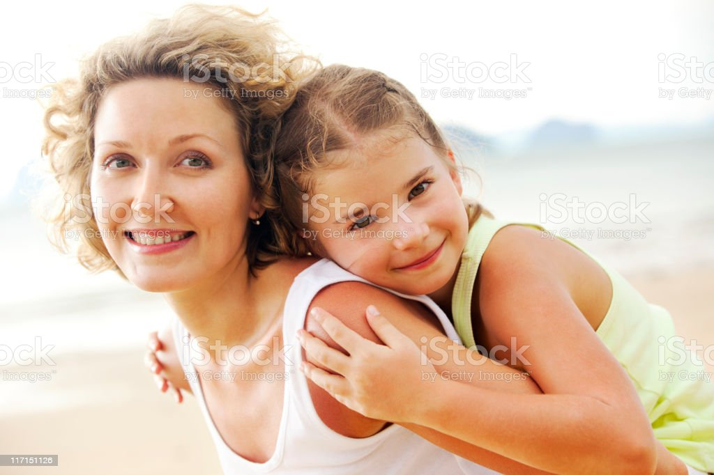 Mother and daughter having fun on beach royalty-free stock photo