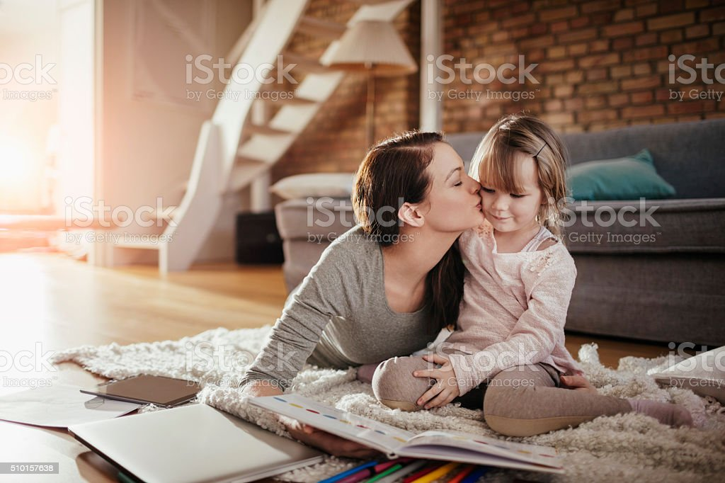 Mother and daughter having fun stock photo