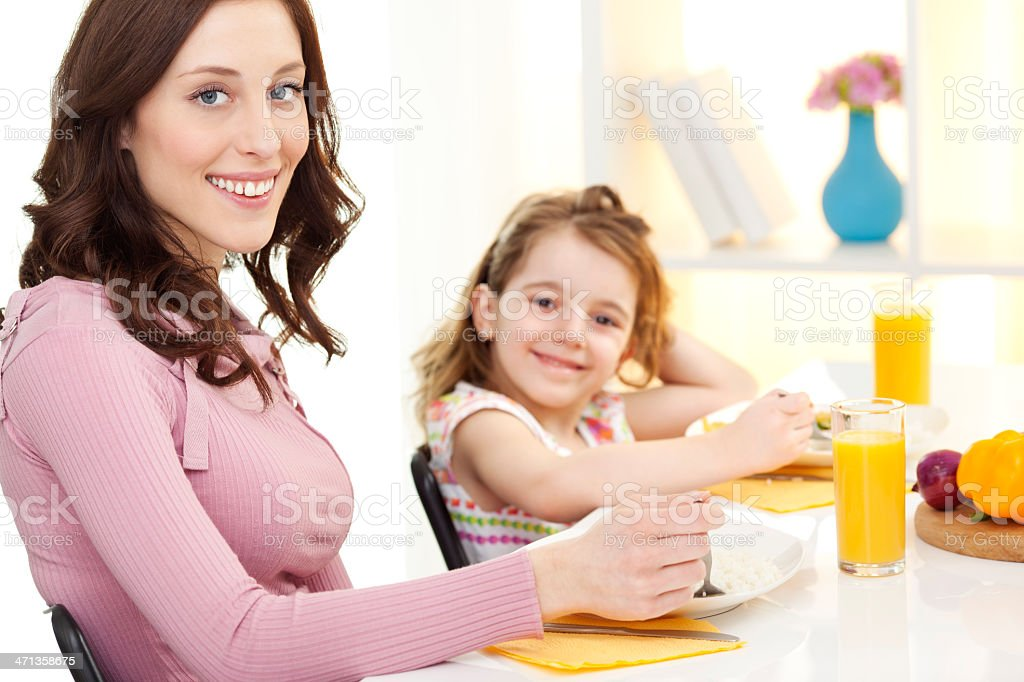 Mother and daughter having meal at the restaurant. royalty-free stock photo