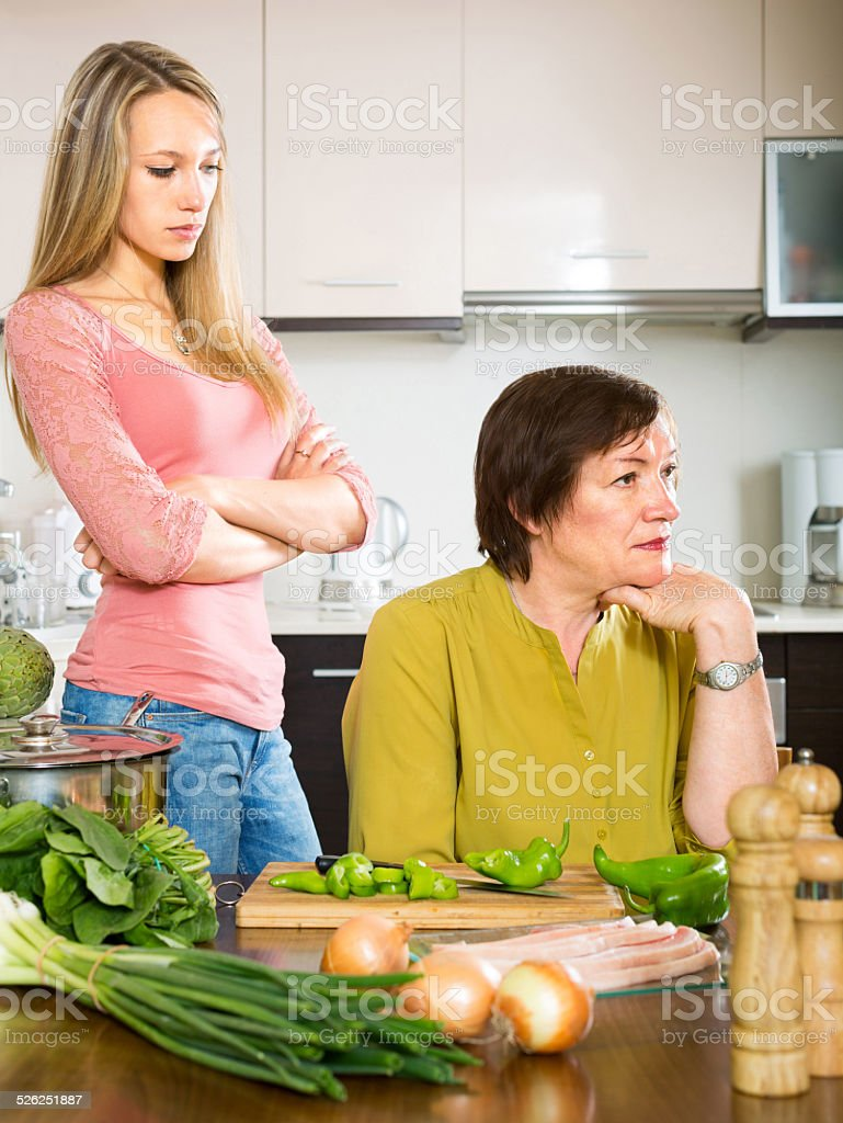 mother and  daughter having quarrel stock photo