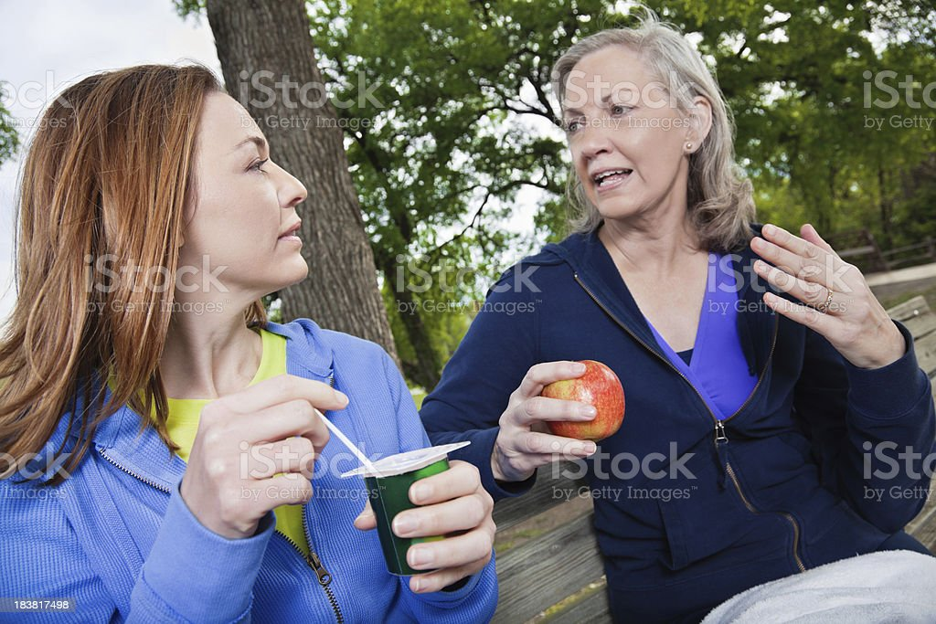 Mother and Daughter Having Serious Conversation While Eating Healthy Food royalty-free stock photo