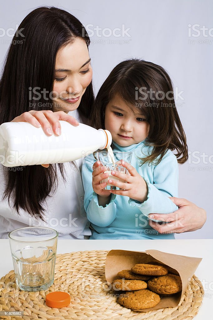 Mother and daughter having snack royalty-free stock photo