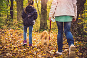 Mother and daughter hiking in a forest
