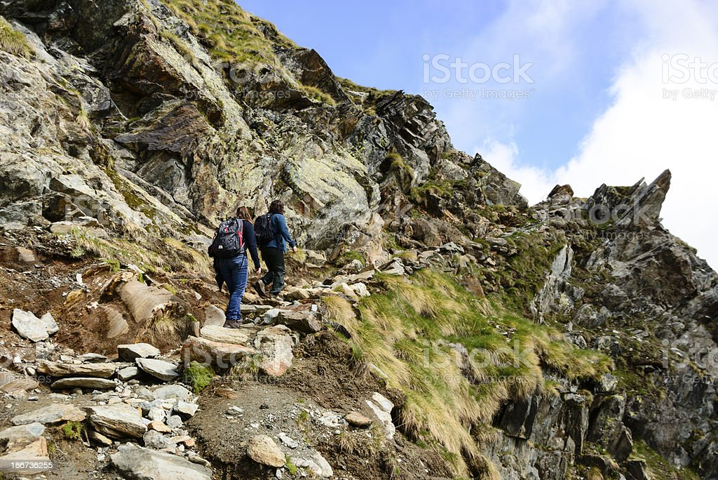 Mother and daughter hiking on a rocky trail -XXXL royalty-free stock photo