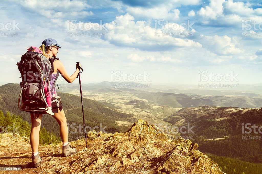 Mother and daughter hiking stock photo