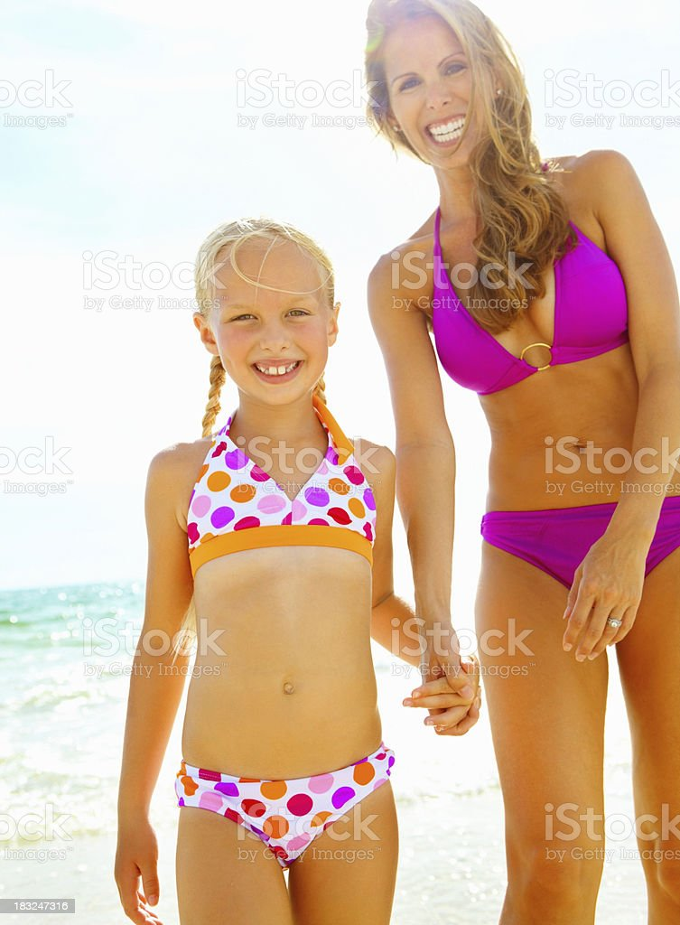 Mother and daughter holding hands on the beach royalty-free stock photo