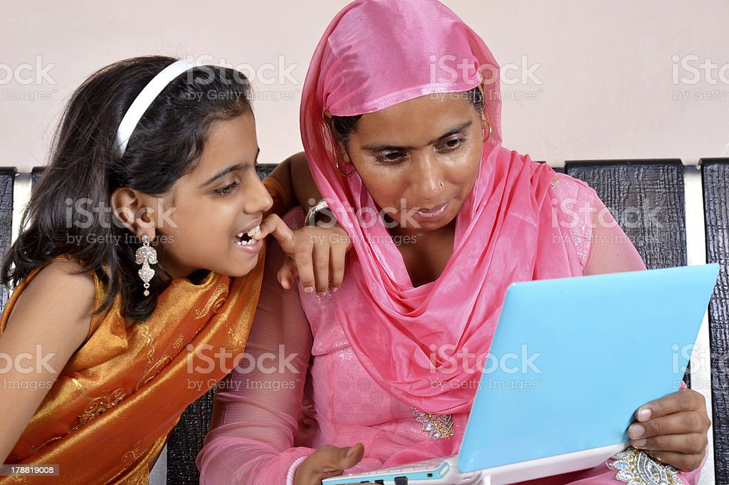 Mother and Daughter Holding Laptop royalty-free stock photo