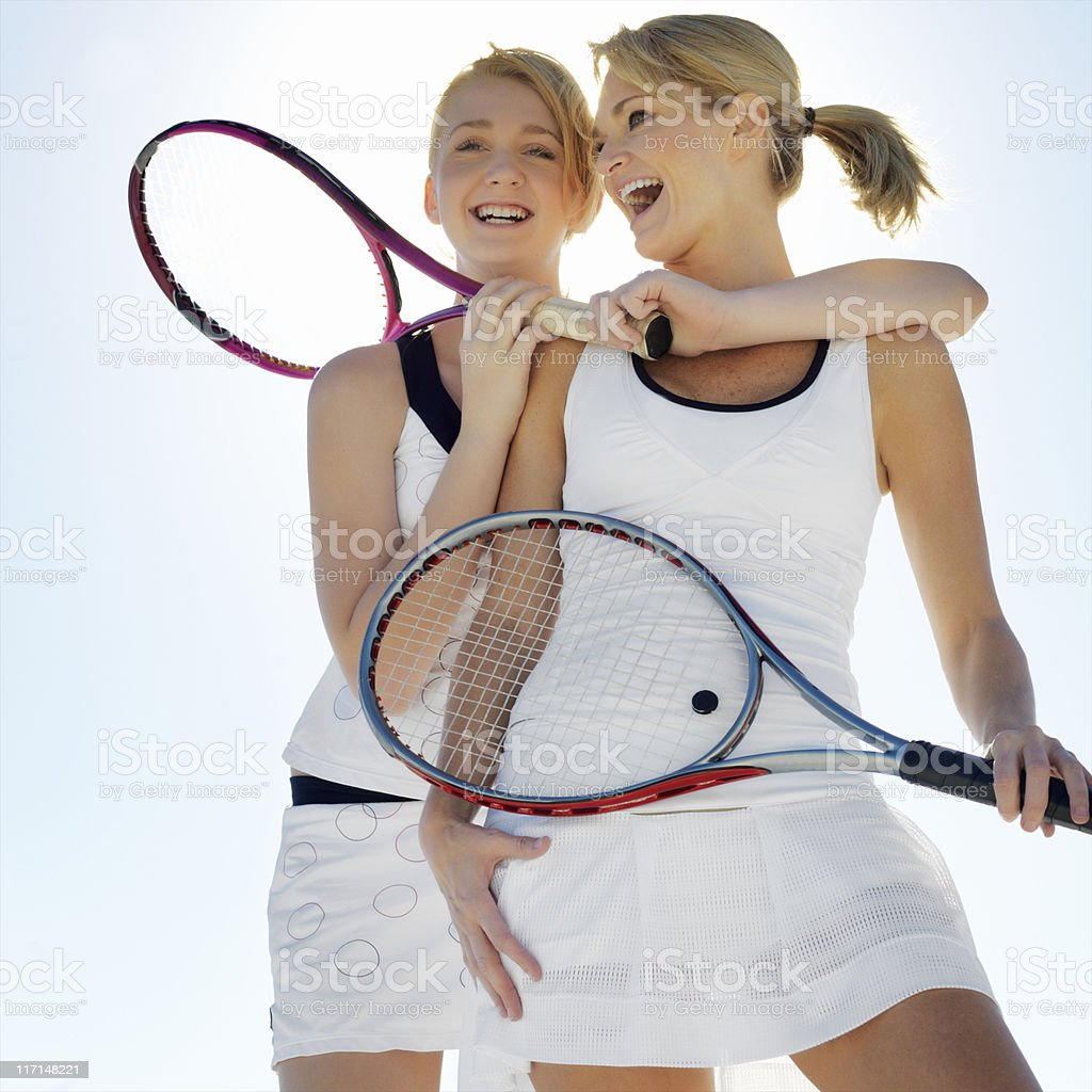 Mother and Daughter Holding Tennis Rackets royalty-free stock photo