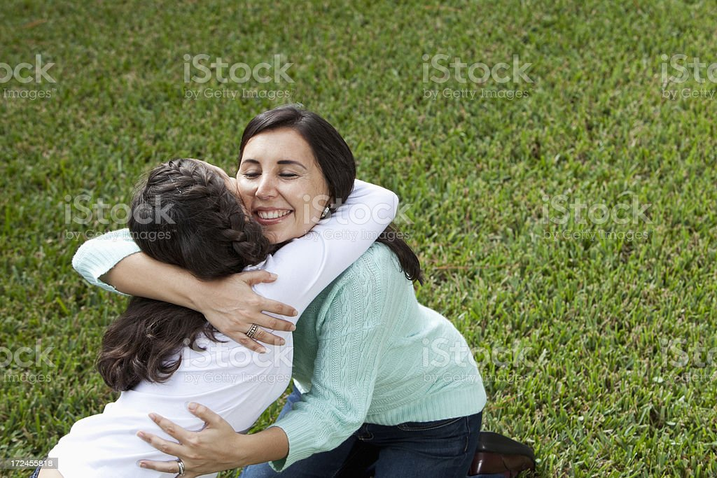 Mother and daughter hug stock photo