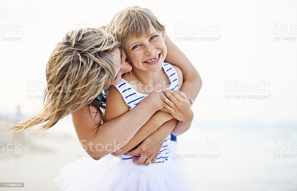 Mother and daughter hugging on the beach royalty-free stock photo