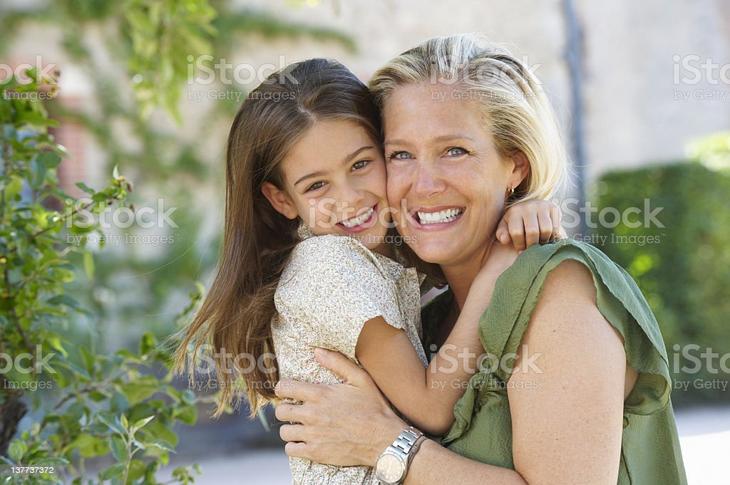 Mother and daughter hugging outdoors royalty-free stock photo