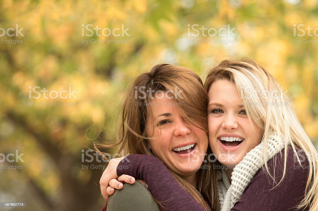 Mother and daughter hugging. stock photo