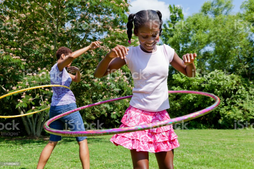 Mother and Daughter Hula Hooping stock photo