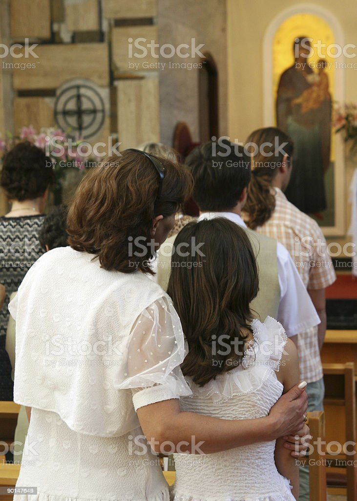 mother and daughter in a Greek Catholic church royalty-free stock photo