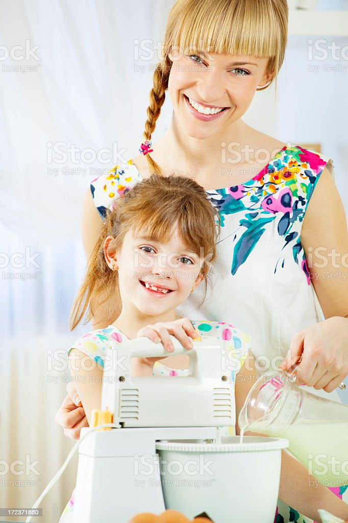 Mother and daughter in a kitchen royalty-free stock photo