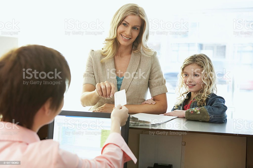 Mother and daughter in a medical office stock photo