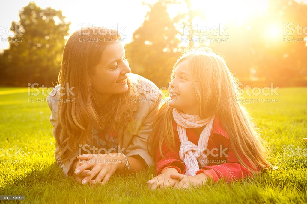 Mother and daughter in a park. stock photo