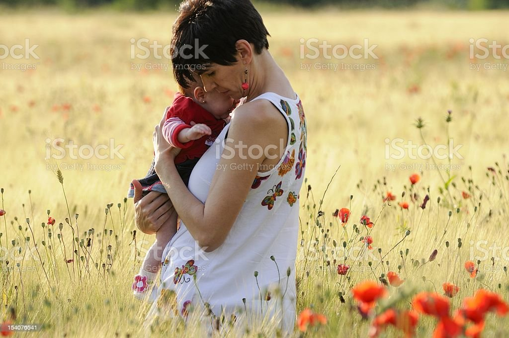 Mother and daughter in a poppy field royalty-free stock photo