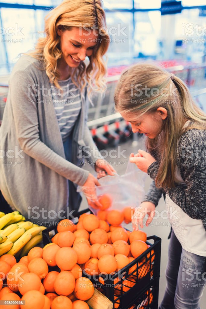 Mother and Daughter In A Supermarket stock photo