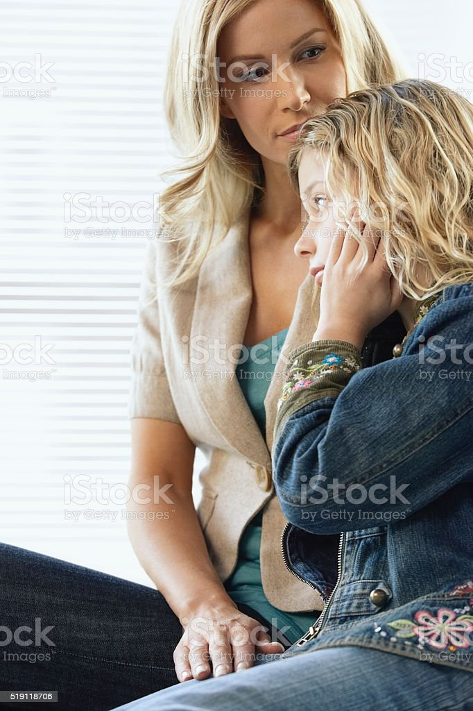 Mother and daughter in a waiting room stock photo