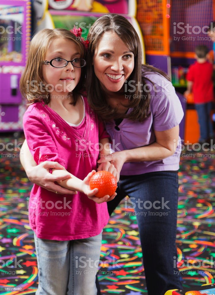 Mother and Daughter in an Amusement Arcade royalty-free stock photo