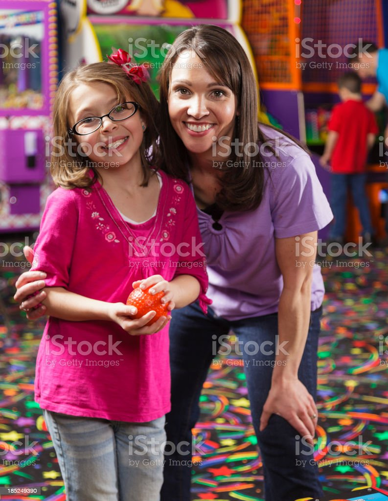 Mother and Daughter in an Amusement Arcade stock photo