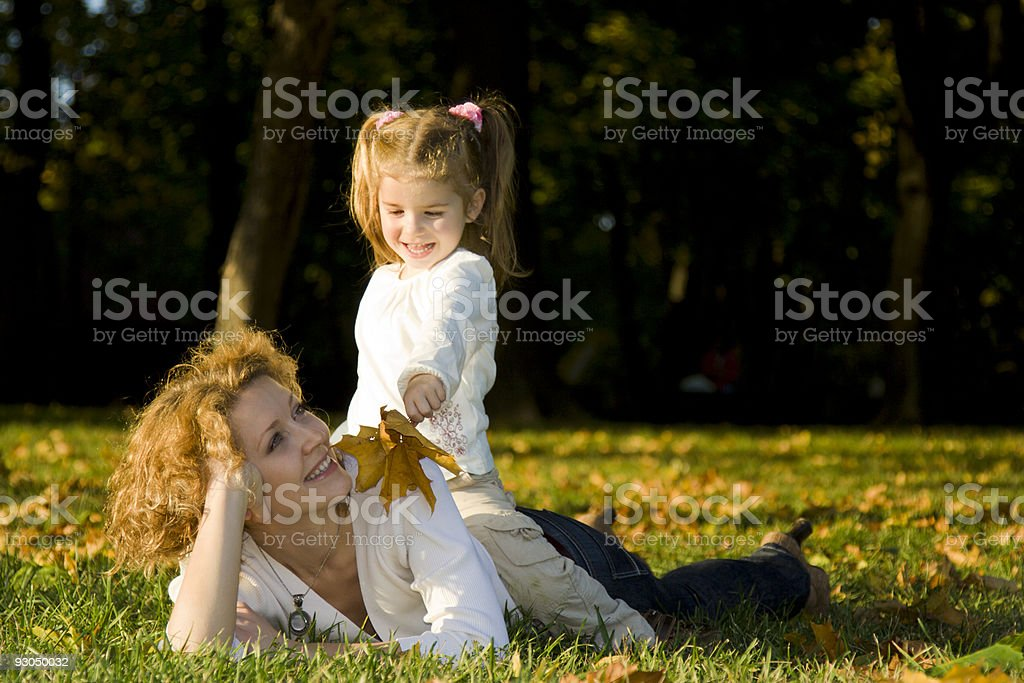 Mother and daughter in autumn park royalty-free stock photo