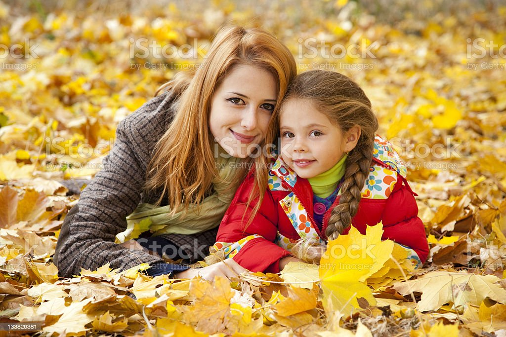 Mother and daughter in autumn yellow park royalty-free stock photo
