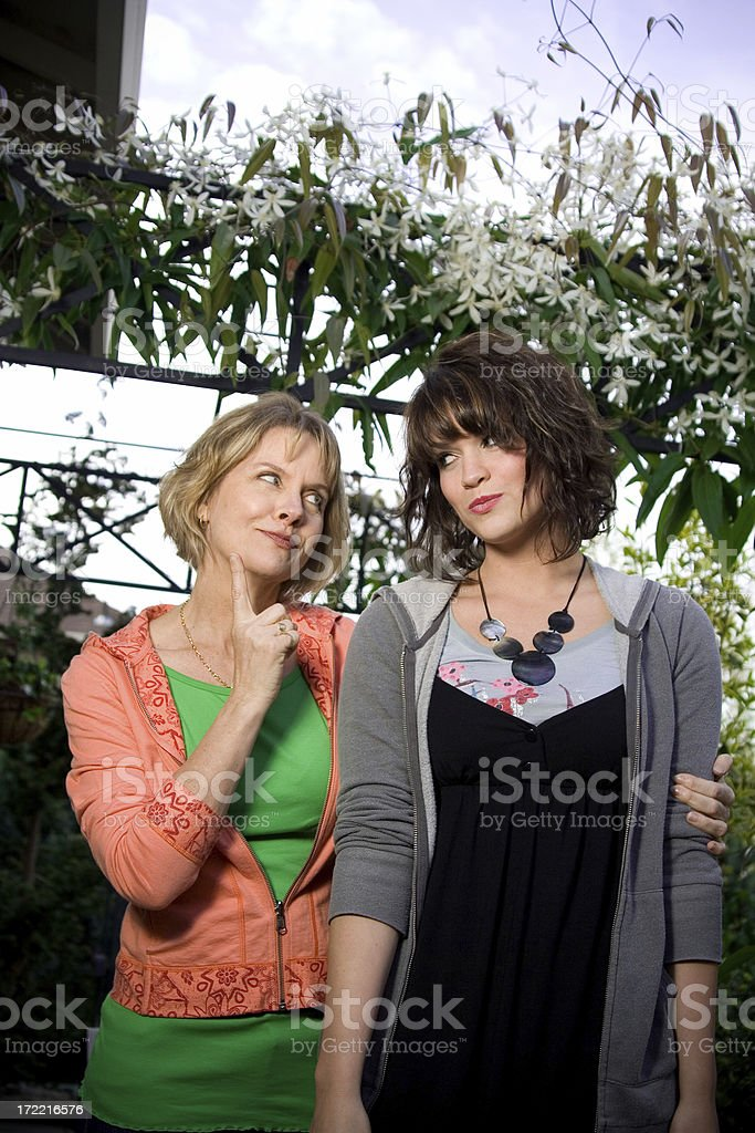 mother and daughter in backyard royalty-free stock photo