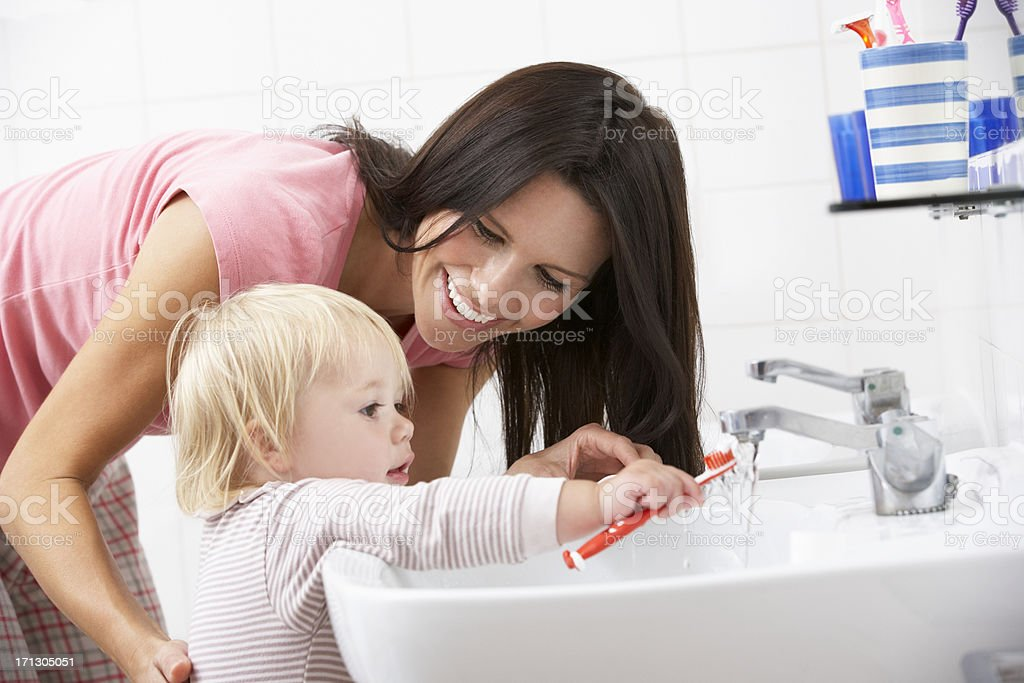 Mother And Daughter In Bathroom Brushing Teeth royalty-free stock photo