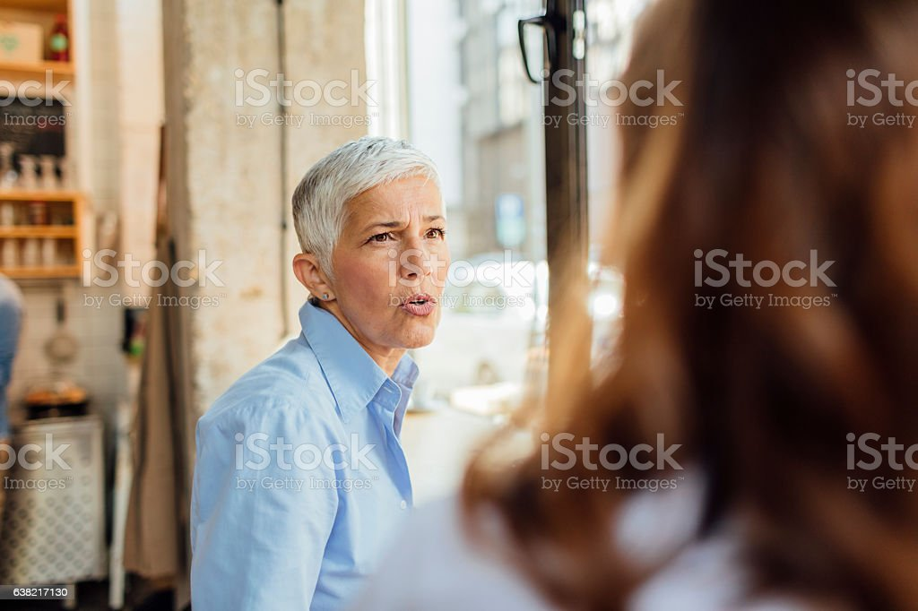 Mother and Daughter In Cafe stock photo